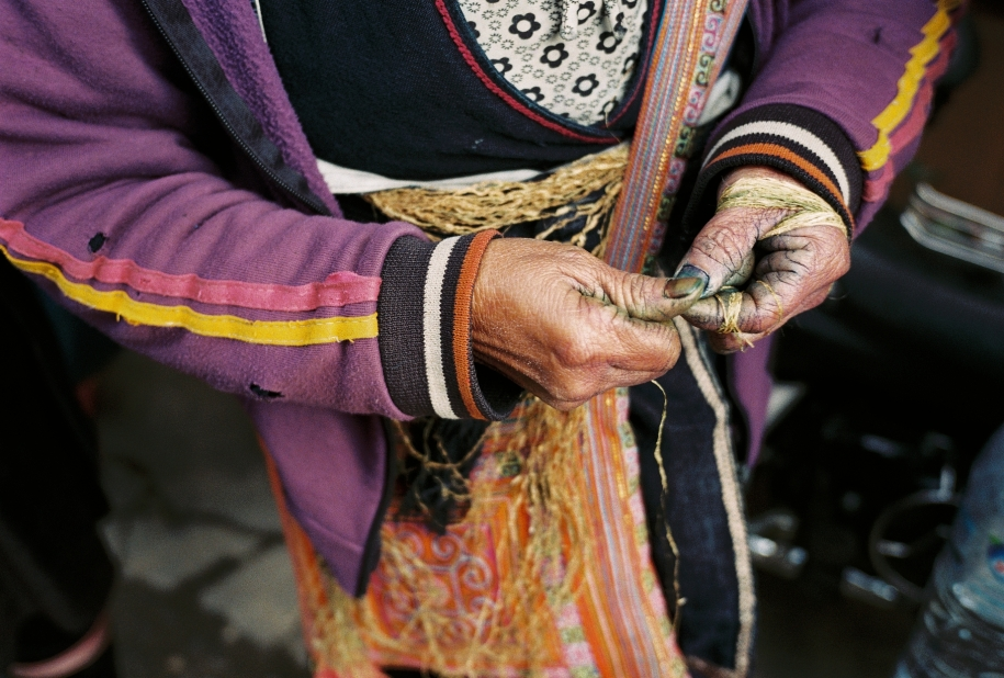 Vietnamese woman's hands weaving