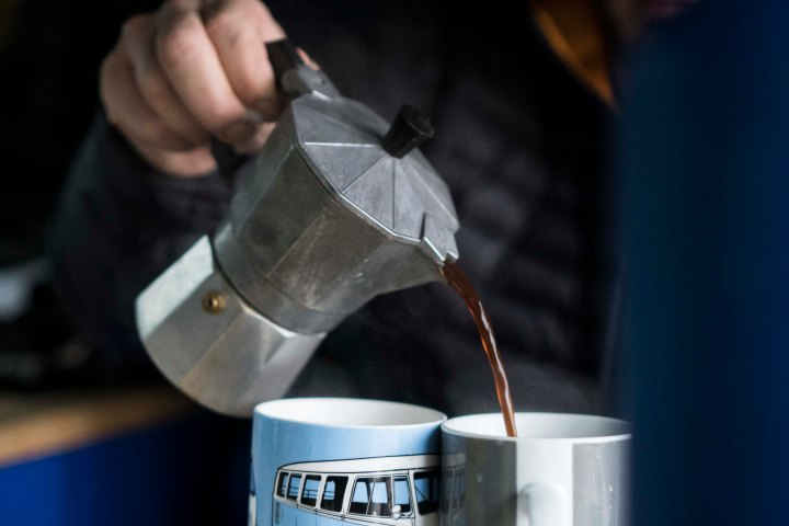 Pouring a cup of freshly brewed coffee in the van